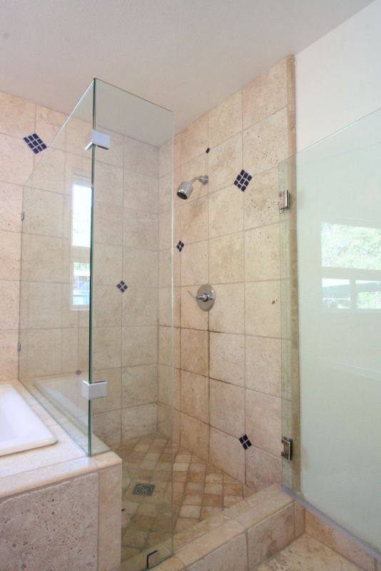 elegant glass shower door highlighting tile