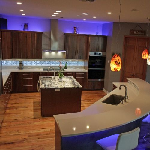 Curved bar and dramatic colored uplighting