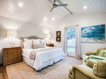 A bright open concept guest bedroom